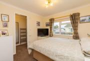 Main double bedroom of pre-owned park home for sale on Burlingham Park Garstang